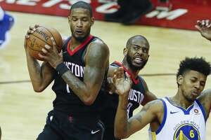 Houston Rockets forward Trevor Ariza (1) grabs a rebound against teammate Chris Paul (3) and Golden State Warriors guard Nick Young (6) during the first half of Game 2 of the Western Conference Finals at the Toyota Center, Wednesday, May 16, 2018, in Houston. ( Karen Warren  / Houston Chronicle )