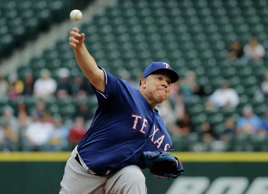Texas Rangers starting pitcher Bartolo Colon throws against the Seattle Mariners during the first inning of a baseball game, Wednesday, May 16, 2018, in Seattle. (AP Photo/Ted S. Warren) Photo: Ted S. Warren / Copyright 2018 The Associated Press. All rights reserved.