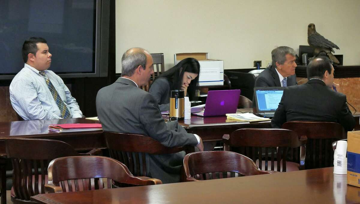 Luis Mercado, left, and his attorneys listen to testimony Wednesday in the 406th District Court.