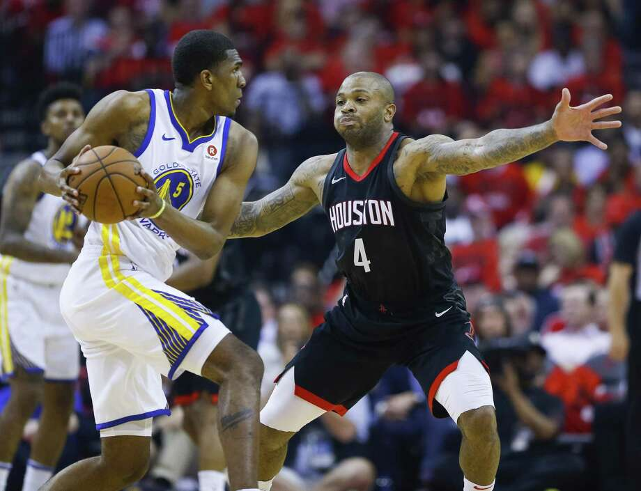 Rockets forward P.J. Tucker, right, cuts off the passing lane for Warriors forward Kevon Looney in Game 2. Photo: Michael Ciaglo, Staff / Houston Chronicle / © 2018 Houston Chronicle