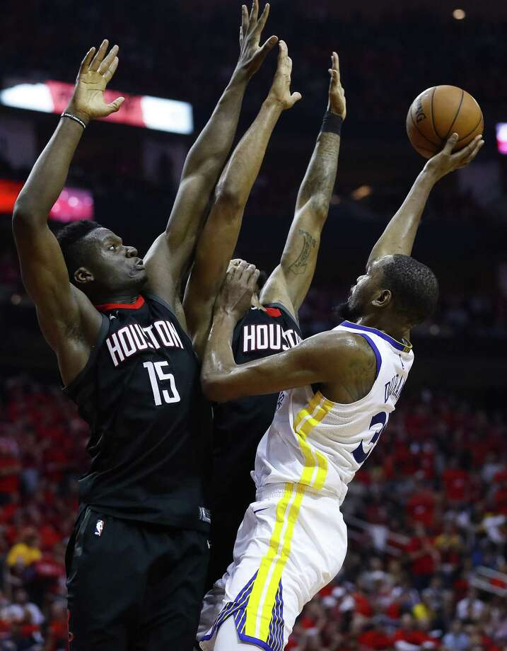 Golden State's Kevin Durant shoots over Rockets center Clint Capela, left, and forward Trevor Ariza during Game 2 Wednesday night. Durant scored 38, but the Rockets defense was solid. Photo: Michael Ciaglo, Staff / Houston Chronicle / © 2018 Houston Chronicle