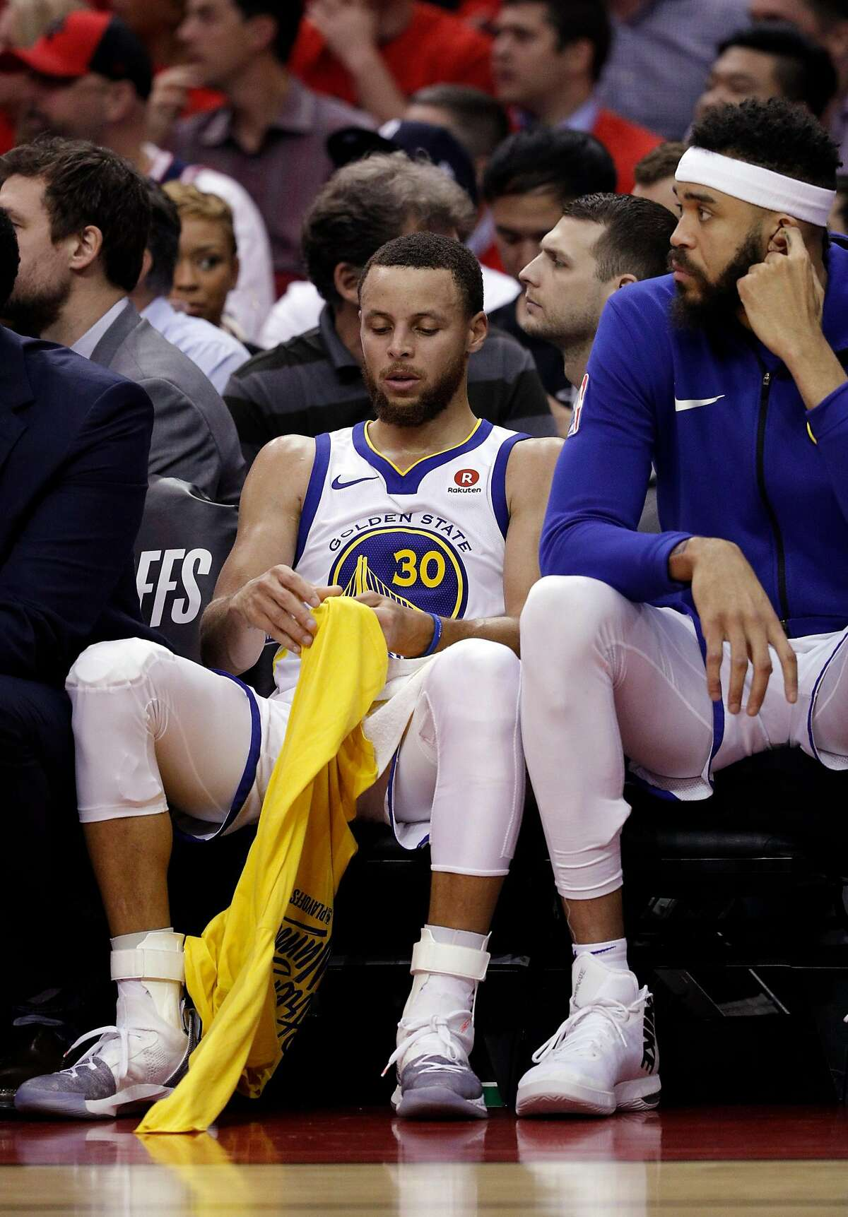 Stephen Curry (30) sits on the bench in the second half as the Golden State Warriors played by the Houston Rockets in Game 2 of the Western Conference Finals at Toyota Center in Houston, Texas, on Wednesday, May 16, 2018. The Rockets won 127-105.