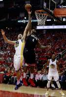 Klay Thompson (11) defends against a shot by PJ Tucker (4) in the second half as the Golden State Warriors played by the Houston Rockets in Game 2 of the Western Conference Finals at Toyota Center in Houston, Texas, on Wednesday, May 16, 2018. The Rockets won 127-105.
