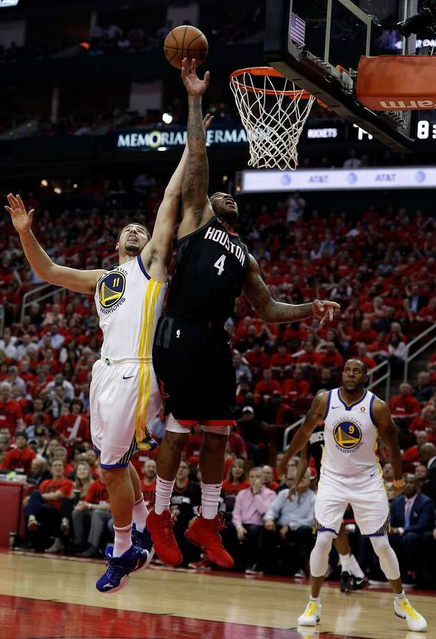 Klay Thompson (11) defends against a shot by PJ Tucker (4) in the second half as the Golden State Warriors played by the Houston Rockets in Game 2 of the Western Conference Finals at Toyota Center in Houston, Texas, on Wednesday, May 16, 2018. The Rockets won 127-105. Photo: Carlos Avila Gonzalez / The Chronicle