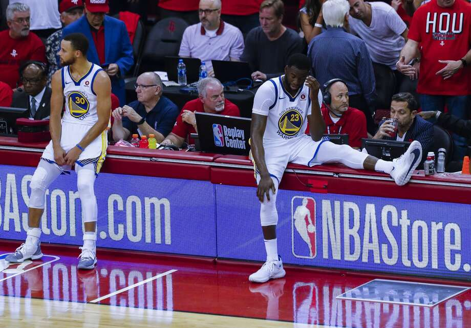 Golden State Warriors guard Stephen Curry (30) and Golden State Warriors forward Draymond Green (23) reacts from the sideline during the second half of Game 2 of the Western Conference Finals at the Toyota Center, Wednesday, May 16, 2018, in Houston. ( Karen Warren  / Houston Chronicle ) Photo: Karen Warren/Houston Chronicle