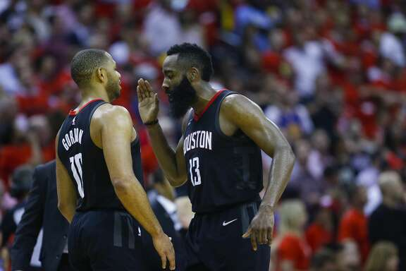 Houston Rockets guard James Harden (13) congratulates Houston Rockets guard Eric Gordon (10) during the second half of Game 2 of the Western Conference Finals at the Toyota Center, Wednesday, May 16, 2018, in Houston. ( Michael Ciaglo  / Houston Chronicle )