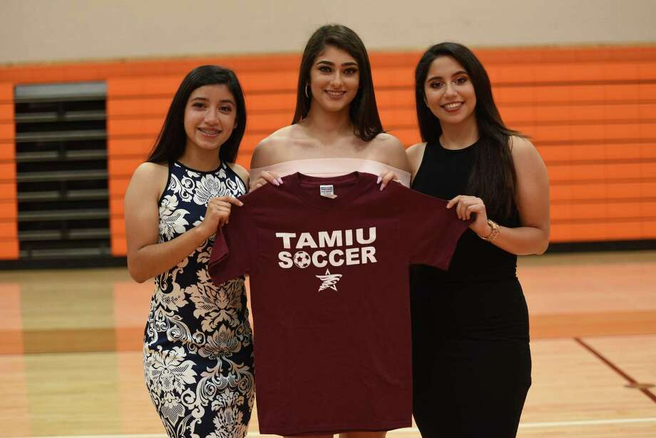 Lady Longhorns girls' soccer players Clarissa Valdez, Montserrat De La Pasqua and Samantha Bernal signed their National Letters of Intent with TAMIU on Wednesday at United. Photo: Christian Alejandro Ocampo /Laredo Morning Times / Laredo Morning Times