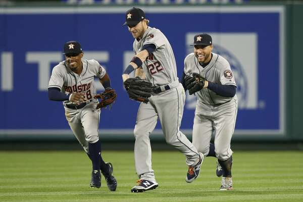 Houston Astros' Tony Kemp, Josh Reddick and George Springer, from left, celebrate the team's 2-0 win over the Los Angeles Angels in a baseball game Wednesday, May 16, 2018, in Anaheim, Calif. (AP Photo/Jae C. Hong)