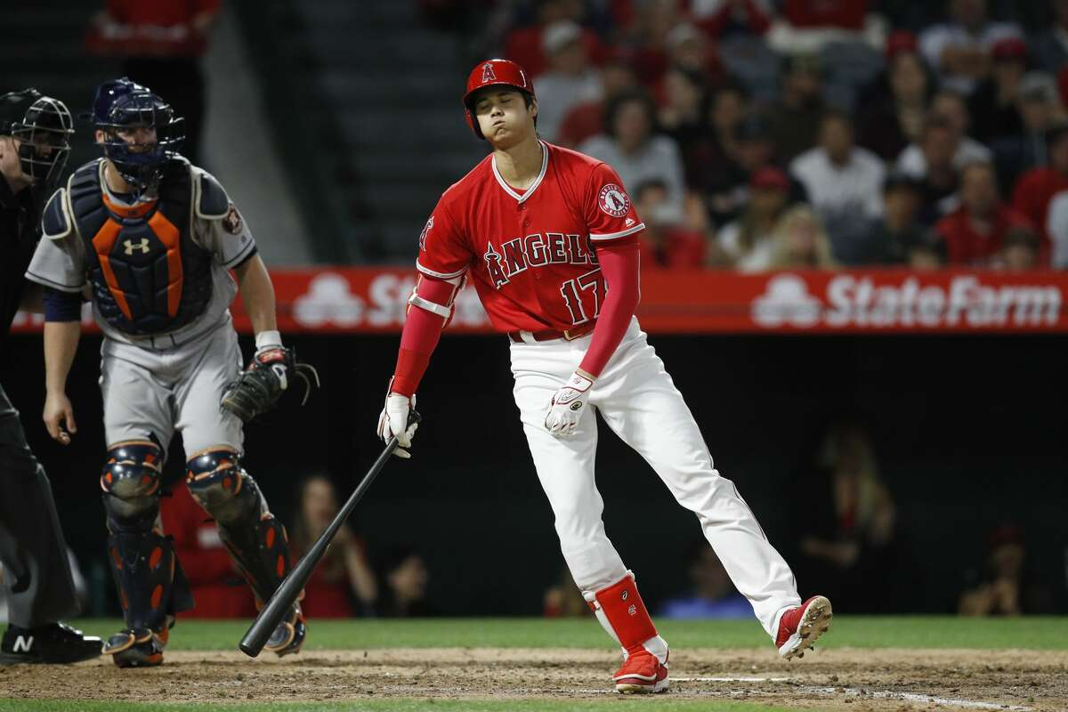 Los Angeles Angels' Shohei Ohtani, of Japan, reacts after striking out during the sixth inning of the team's baseball game against the Houston Astros on Wednesday, May 16, 2018, in Anaheim, Calif. (AP Photo/Jae C. Hong)