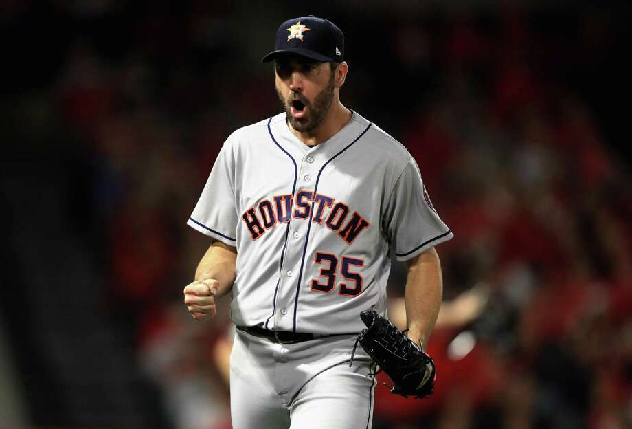 Justin Verlander was revved after retiring Mike Trout with runners at second and third to end the eighth. Photo: Sean M. Haffey, Staff / Getty Images / 2018 Getty Images