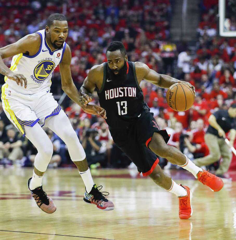 Rockets guard James Harden makes his move around Warriors forward Kevin Durant. Harden had 27 points and 10 rebounds to Durant's 38 and three. Photo: Michael Ciaglo, Staff / Houston Chronicle / © 2018 Houston Chronicle
