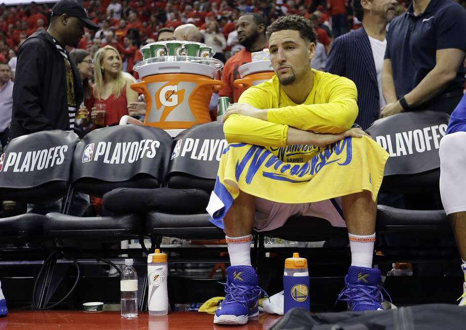 Golden State Warriors guard Klay Thompson (11) sits on the bench during the second half in Game 2 of the NBA basketball Western Conference Finals against the Houston Rockets, Wednesday, May 16, 2018, in Houston. (AP Photo/David J. Phillip) Photo: David J. Phillip / Associated Press