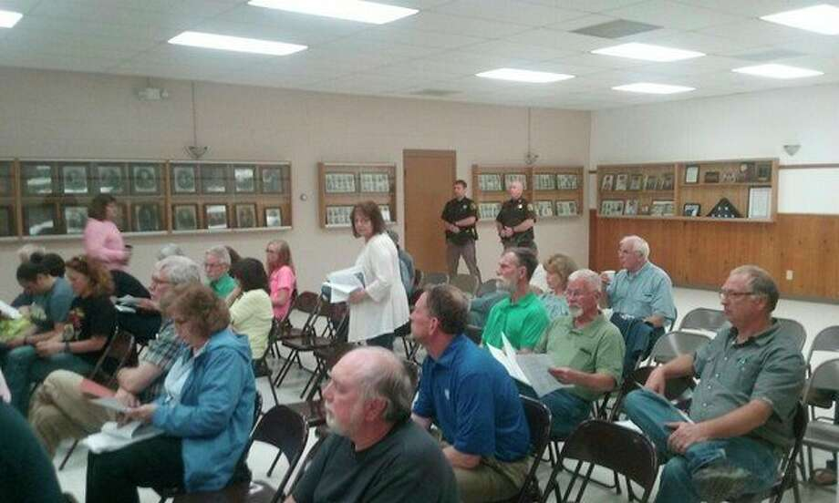 A crowd of Ingersoll Township residents attends Monday's board meeting when the board adopted its wind ordinance. John Kennett/jkennett@mdn.net