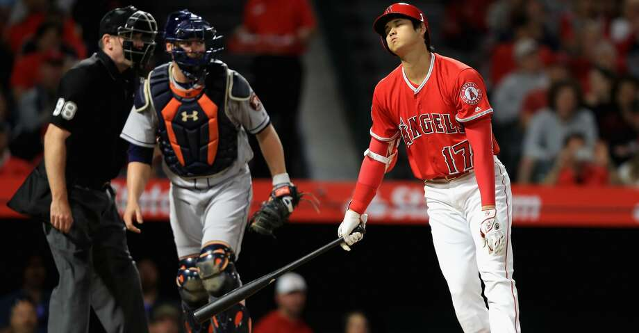 ANAHEIM, CA - MAY 16:  Shohei Ohtani #17 of the Los Angeles Angels of Anaheim strikes out as Brian McCann #16 of the Houston Astros looks on during the sixth inning of a game at Angel Stadium on May 16, 2018 in Anaheim, California.  (Photo by Sean M. Haffey/Getty Images) Photo: Sean M. Haffey/Getty Images