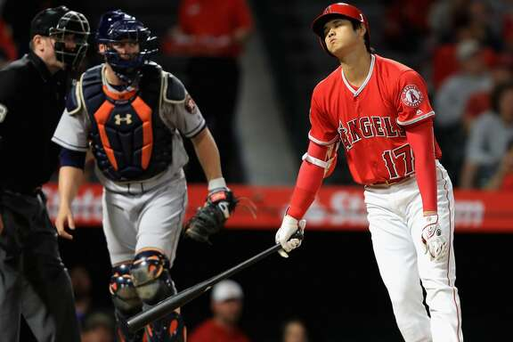 ANAHEIM, CA - MAY 16:  Shohei Ohtani #17 of the Los Angeles Angels of Anaheim strikes out as Brian McCann #16 of the Houston Astros looks on during the sixth inning of a game at Angel Stadium on May 16, 2018 in Anaheim, California.  (Photo by Sean M. Haffey/Getty Images)