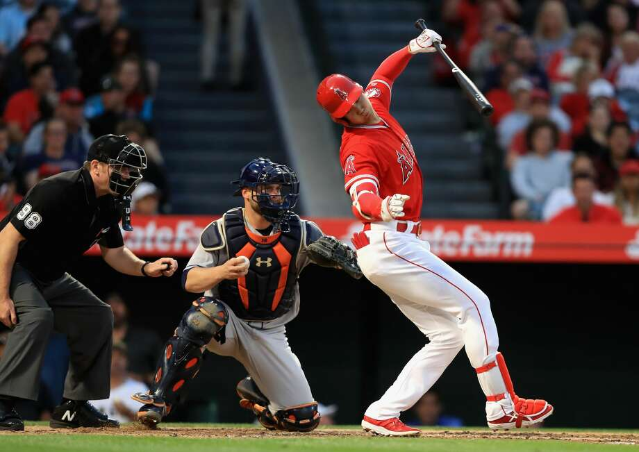 ANAHEIM, CA - MAY 16:  Shohei Ohtani #17 of the Los Angeles Angels of Anaheim loses his balance at bat as Brian McCann #16 of the Houston Astros looks on during the fourth inning of a game  at Angel Stadium on May 16, 2018 in Anaheim, California.  (Photo by Sean M. Haffey/Getty Images) Photo: Sean M. Haffey/Getty Images
