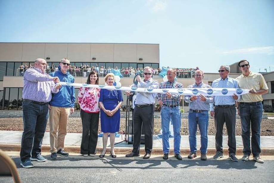 Dot Foods opened a new $14 million expansion. Pictured left to right: Matt Holt, vice president of Human Resources; Dick Tracy, president; Anita Montgomery, chief financial officer; Dorothy Tracy, Dot Foods co-founder; Joe Tracy, CEO; John Long, Sr. vice president of Warehousing; Bill Mummey, director of Corporate Facilities; John Tracy, executive chairman; and Cullen Andrews, vice president of Sales and Marketing. Photo:       Photo Submitted