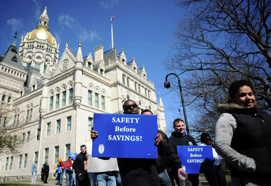 Hundreds of unionized state employees joined together to march outside of the state Capitol building to underscore how potential layoffs will affect Connecticut's quality of life in Hartford, Conn. on Tuesday, March 29, 2016. Photo: Michael Cummo / Hearst Connecticut Media / Stamford Advocate