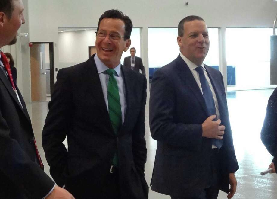 John Visentin, right, alongside Gov. Dannel P. Malloy in March 2015 in Windsor, Conn. On May 17, 2018, Norwalk-based Xerox confirmed the hire of Visentin as CEO, with Visentin to receive $11.5 million up front and as much as $13.6 million more in annual compensation. Photo: Alexander Soule / Alexander Soule / Stamford Advocate