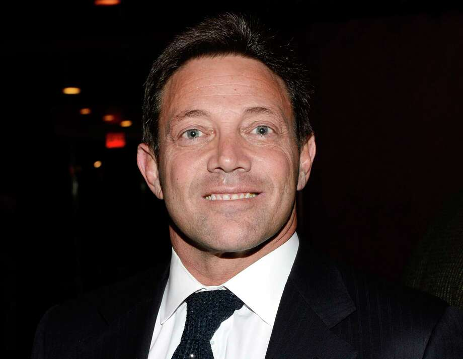 "FILE - In this Tuesday, Dec. 17, 2013, file photo, Jordan Belfort attends the premiere party for ""The Wolf of Wall Street"" at the Roseland Ballroom in New York. On Wednesday, May 16, 2018, a federal judge in New York City said she wants to make sure real-life ""Wolf of Wall Street"" Belfort continues to pay back the nearly $100 million he owes in restitution. Belfort has so far paid off about $13 million of an owed $110 million in restitution. Photo: Evan Agostini, AP / Invision"