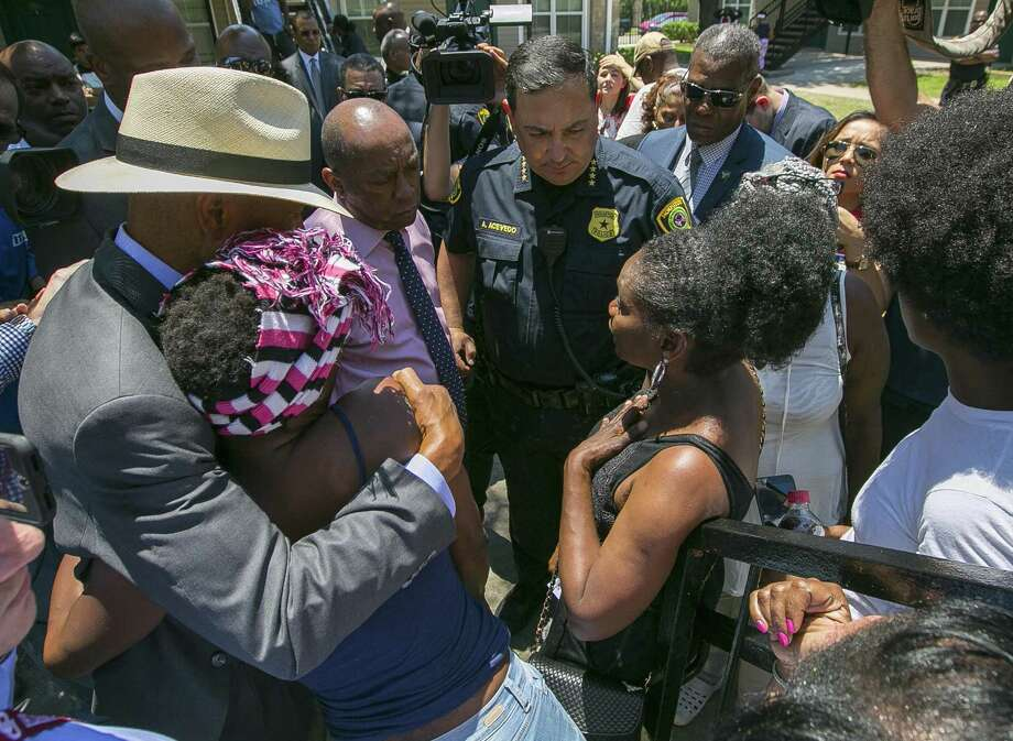 Texas State Senator Borris Miles hugs Kings Row Apartments resident Natasha McBride as Houston Mayor Sylvester Turner and Houston Police Department Chief Art Acevedo speak to friends and family members of the three-year-old boy who was shot Tuesday night at the Kings Row Apartments off of Scott Street, Wednesday, May 16, 2018, in Houston. Elected officials and law enforcement urged residents to come up with information identifying the shooter while residents asked for security and a way out of the apartments that they say are perpetually plagued by violence. ( Mark Mulligan / Houston Chronicle ) Photo: Mark Mulligan, Houston Chronicle / Houston Chronicle / © 2018 Houston Chronicle