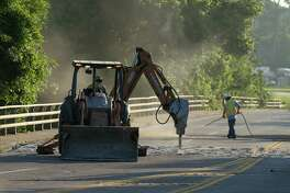 Construction crews work to repair a buckling section of Wallisville Road that crosses Greens Bayou Thursday, May 17, 2018, in Houston. Wallisville Road is closed between Normandy Street and Dattner Road.