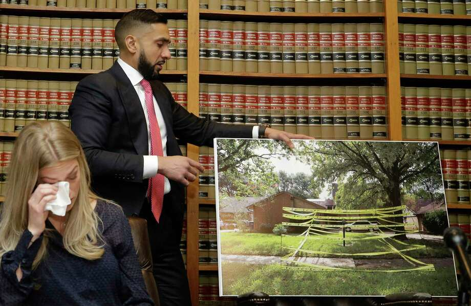 Alyssa Davidson, left, wipes her tears as attorney Muhammad Aziz displays a photo of the area where her brother, Andrew Pasek, was electrocuted and died while going to her home to save cat during the aftermath of Harvey, shown during a press conference at Abraham, Watkins, Nichols, Sorrels, Agosto & Aziz, 800 Commerce St., Wednesday, May 16, 2018, in Houston. The family is suing several companies, including CenterPoint Energy. Photo: Melissa Phillip, Houston Chronicle / © 2018 Houston Chronicle