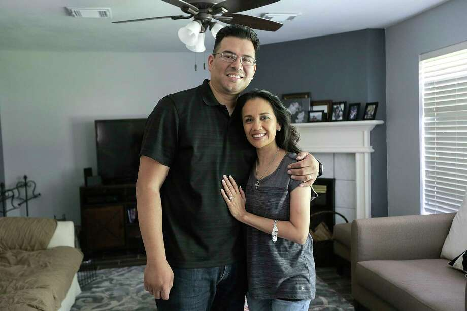 Oliver and Susan Lee stand in the family room of their renovated home. When Hurricane Harvey sent 10 inches of water into their home, the Lees got busy and did some of the work themselves. Like others without flood insurance, many homeowners are learning new home do-it-yourself skills to put their homes back together on a budget. Photo: Elizabeth Conley, Houston Chronicle / ©2018 Houston Chronicle