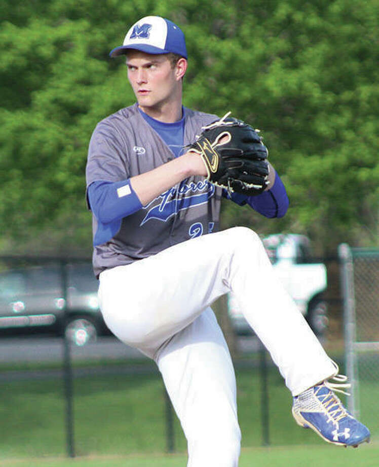 Marquette Catholic pitcher Nick Hemann, shown throwing earlier this month at Hopkins Field in Alton, turned in a complete game Wednesday and earned a win when Montana Gossage drove in two runs to give the Explorers' a 2-1 victory over Belleville Althoff in the semifinals of the Wesclin Class 2A Regional in Trenton. Photo:       Greg Shashack / The Telegraph