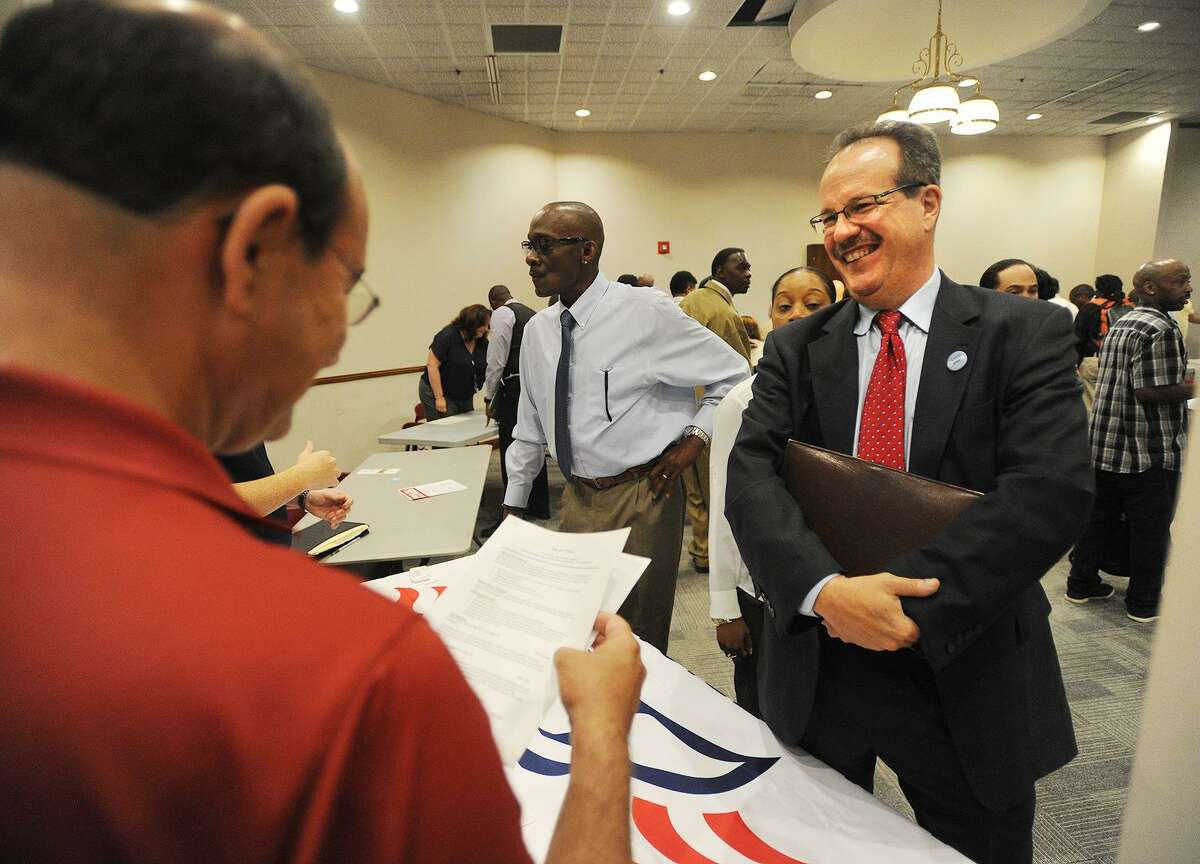 Rich Bachman, right, of Fairfield, gives his resume to Ken Vallera, of All American Waste at the Bridgeport Re-Entry Career Fair, at the Margaret Morton Government Center in Bridgeport, Conn., on June 28, 2017.