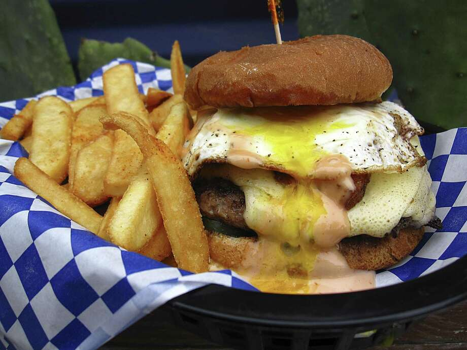 A Folc Burger with cheese, a fried egg, pork belly and Folc sauce with fries from Bexar Pub. The pub is closing for repairs starting Aug. 12. Photo: Mike Sutter /Staff