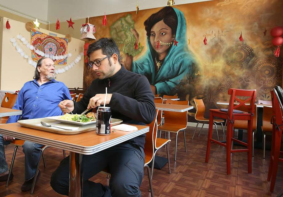Miguel Gallucci (foreground) visiting from France eats lamb at Z Zoul Cafe in the Tenderloin. Photo: Liz Hafalia / The Chronicle