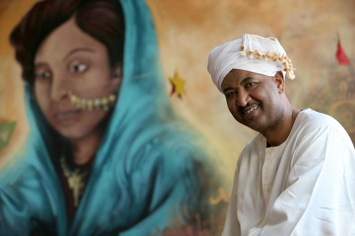Owner and chef Aref Elgaali shows a mural, artist replica of his mother, in the first Sudanese restaurant in the region on Tuesday, May 15, 2018 in San Francisco, Calif.