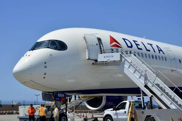 "Delta A350's distinctive ""raccoon eyes"" cockpit windows"
