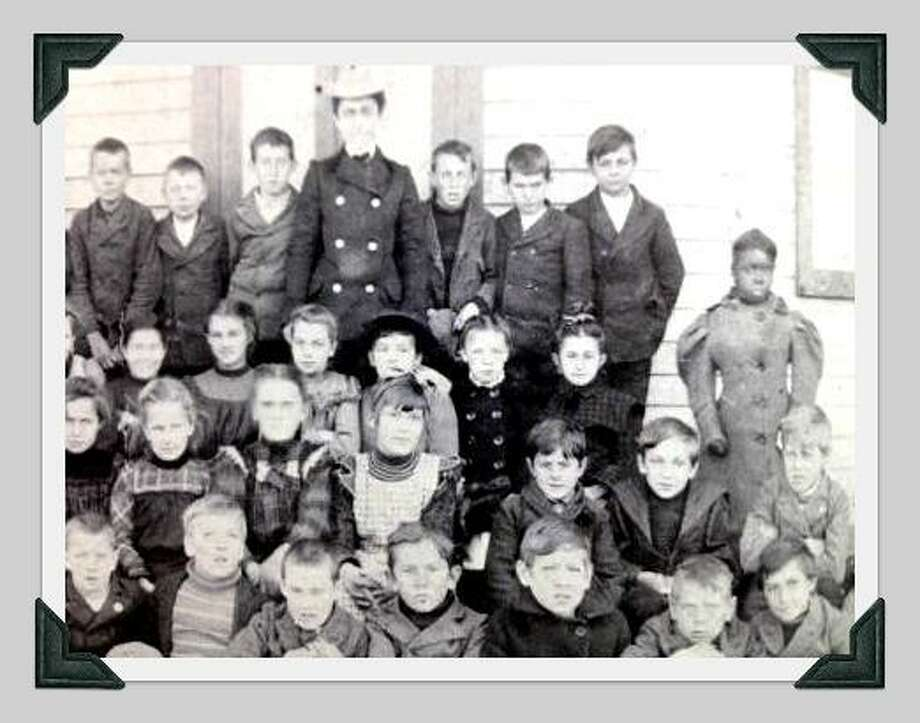 The only black child in this undated Westport school photo stands apart from her classmates, on the far right. Photo: /