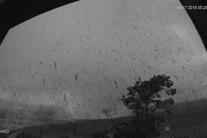 A screen shot from the HVO Observation Tower webcam showing the results of an ash plume explosion at Kīlauea  Volcano's summit on May 17, 2018.