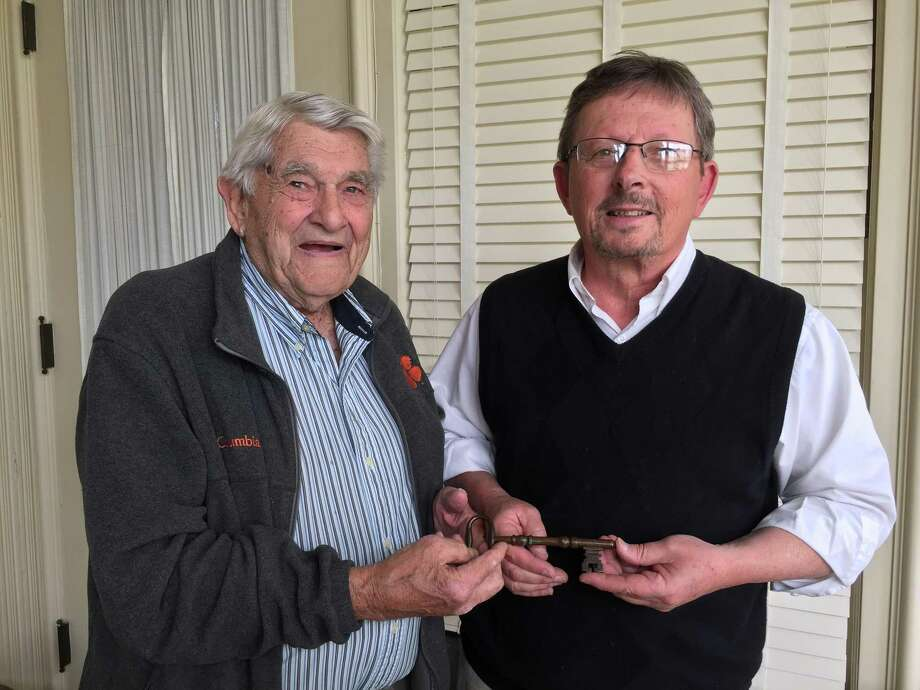 John C. Hoyt, left, of Manning South Carolina donated the key to the John Brown Birthplace to the Torrington Historical Society on May 11. Hoyt is pictured with the society's executive director, Mark McEachern. Photo: Contributed Photo