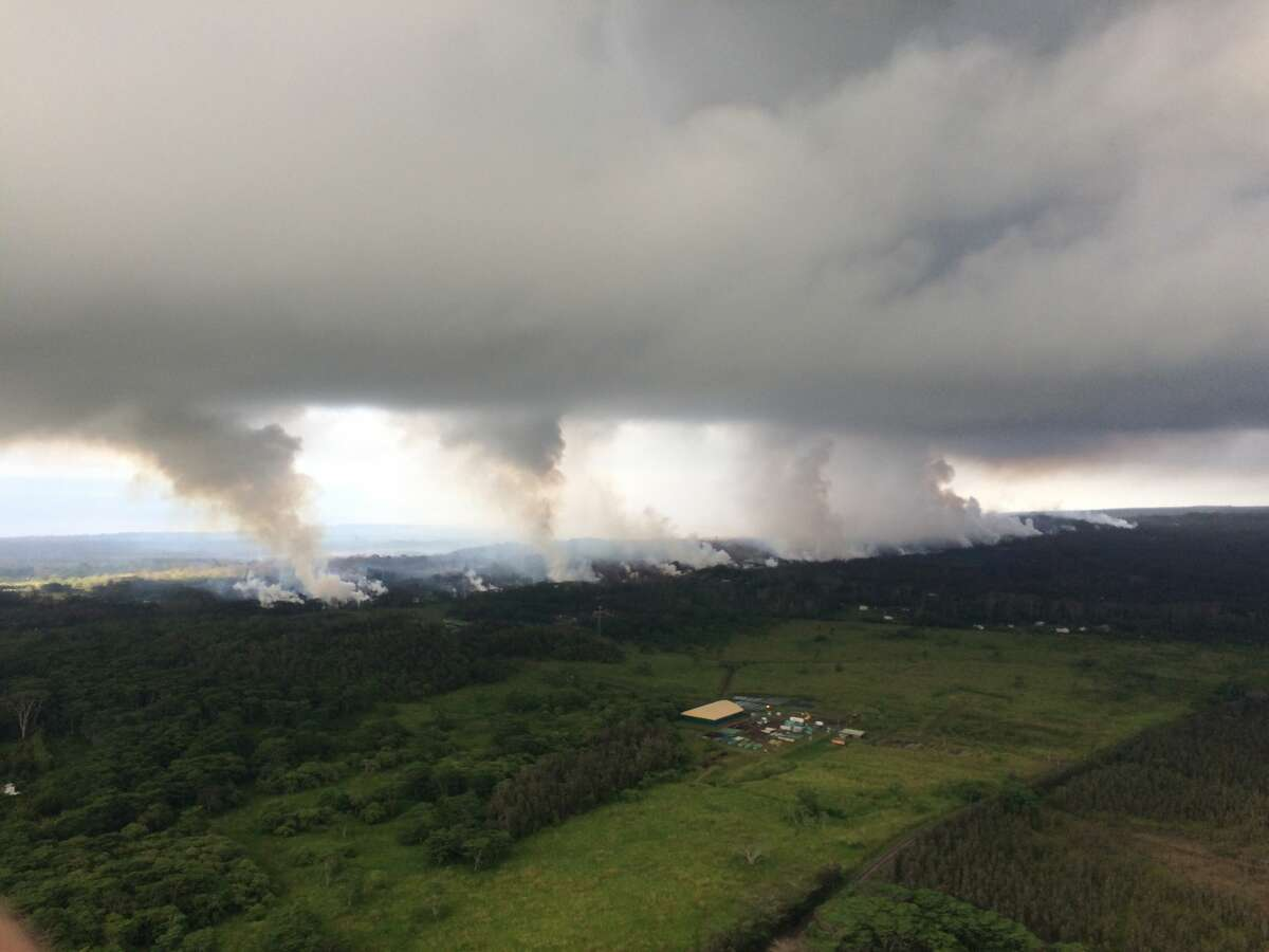 View uprift of Kilauea Volcano from the Hawaiian Volcano Observatory overflight on May 17, 2018. Note sulfur dioxide plumes rising from the fissures along the rift and accumulating in the cloud deck.