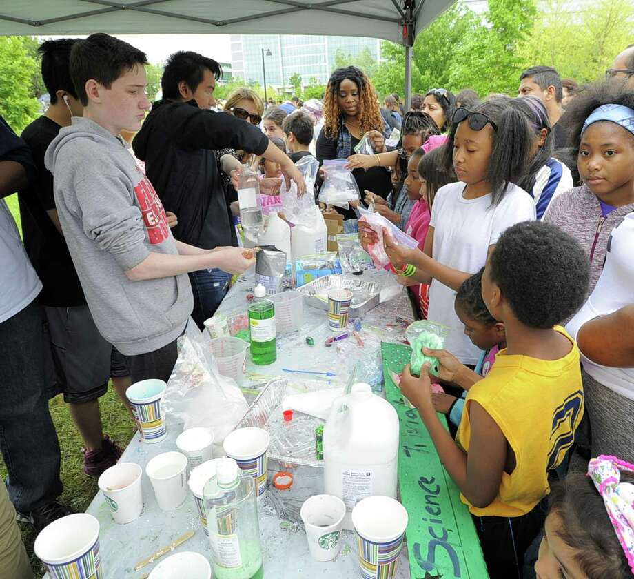 Families gather to make Slime out of common food items most households have in their pantries during the fourth annual STEMFest at Mill River Park in Stamford, Conn. on May 20, 2017. The free, day-long festival by Stamford Public Schools, featured hands-on science, technology, engineering and math activities for all ages. Photo: Matthew Brown / Hearst Connecticut Media / Stamford Advocate