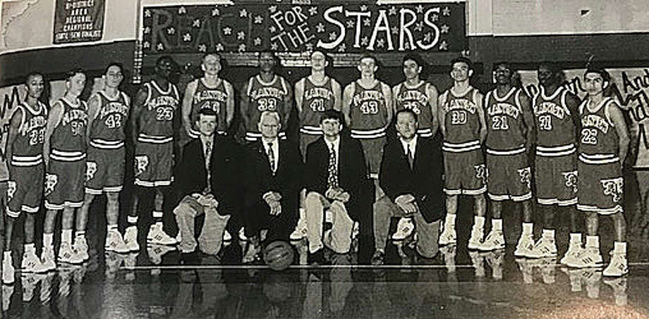 Carl Irlbeck (front, second from left) poses with his Plainview High School boys basketball team that won the state championship in 1994. Pictured with Irlbeck are (l-r) assistant coaches David Manchee, John Smith and Tracey Summers. Players standing are (l-r) Michael O'Neal, Scott Parr, Tory Bryant, Marcus Williams, Rob Bass, Steven Ridley, Mickey Marshall, Joel Stary, Juan Gomez, Ruben DeLeon, Dibi Ray, Jira Sansom and Steven Gonzalez. Irlbeck is being inducted into the 2018 Texas Association of Basketball Coaches Hall of Fame on Saturday in San Antonio.