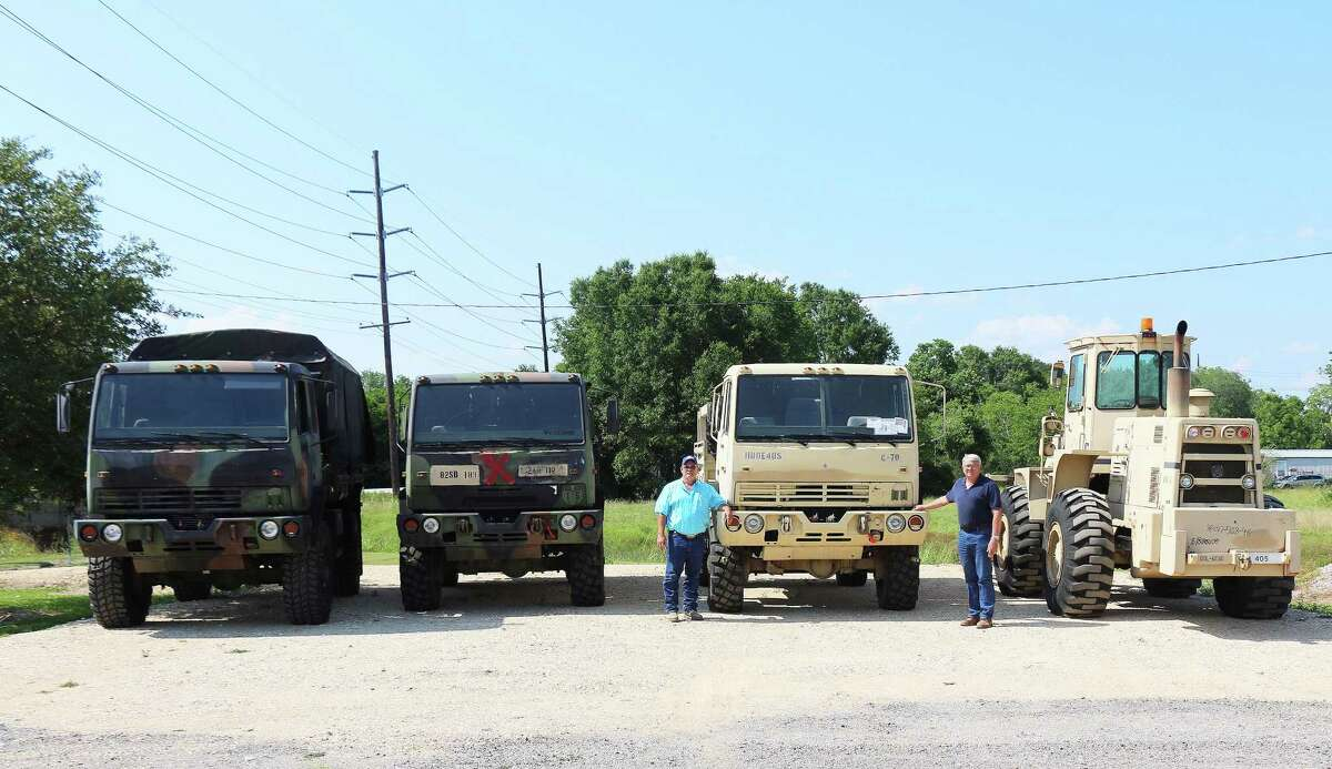 The military-grade high-water vehicles sit in the Pct. 1 yard in Raywood following delivery on Monday, May 14.