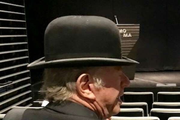 Sandy Walker in bowler at preview of Magritte exhibition at SFMOMA