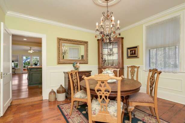 """The 3,271-square foot Greek revival at 1745 Huntington Turnpike in Trumbull was built in 1838, a fact memorialized by the home's door knocker, which reads """"Edwards 1838."""" The knocker is one of many traces of the home's rich history that remain in the home, with others including most of the original wideboard floors. The house, built by Samuel Edwards, sits across from the Nichols green and 42 acres of private parkland."""