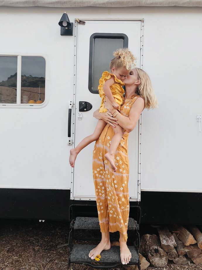 A California family of five sold their five-bedroom home to buy a 2.2-acre piece of rural land in Ventura County. To save money to build their dream home on their land, they're living in a 150-square-foot fully renovated trailer. See photos of their groovy living situation on Instagram at @arrowsandbow. Photo: Instagram: @arrowsandbow