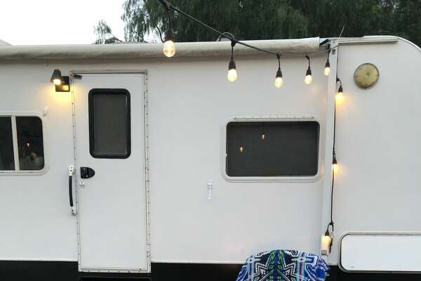 A California family of five sold their five-bedroom home to buy a 2.2-acre piece of rural land in Ventura County. To save money to build their dream home on their land, they're living in a 150-square-foot fully renovated trailer. See photos of their groovy living situation on Instagram at  @arrowsandbow .
