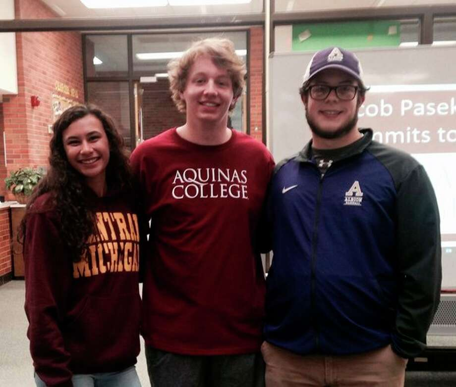 From left, Dow High's Maija Rettelle will compete for Central Michigan University track and field, Jacob Pasek for Aquinas College men's volleyball and Nolan Saggers for Albion College baseball.