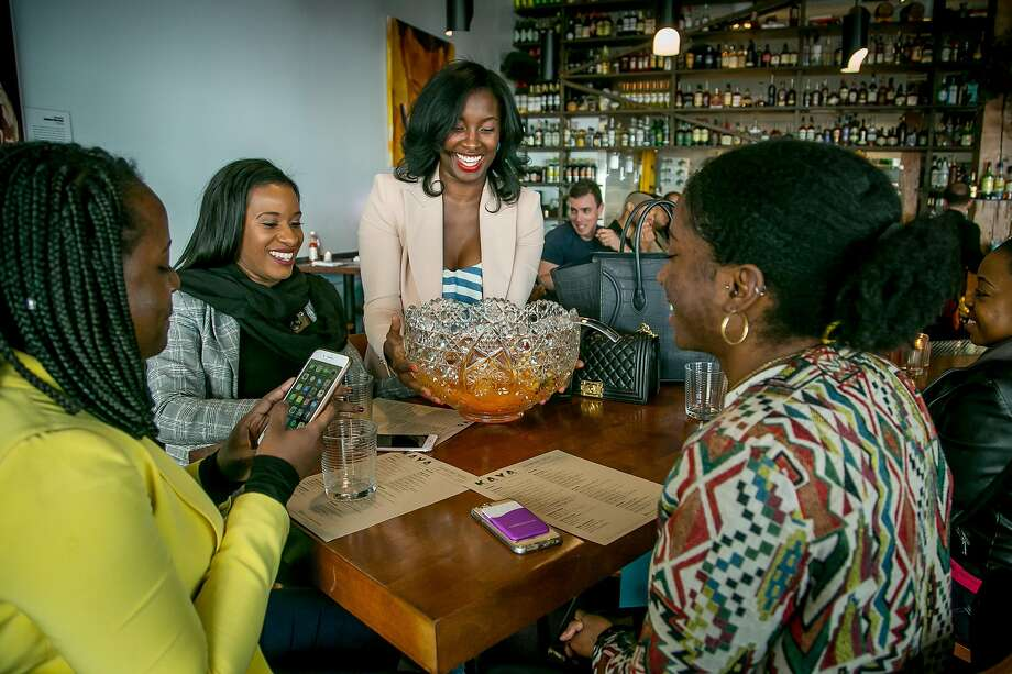 Safiya Jihan brings a punch bowl to her friends at Kaya in San Francisco, Calif. on March 24th, 2018. Photo: John Storey / Special To The Chronicle