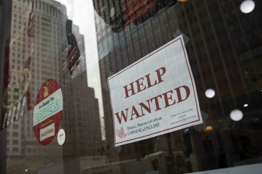 A 'help wanted' sign hangs on a window of a restaurant in Lower Manhattan, May 4, 2018 in New York City. U.S. unemployment fell to a near historic low of 3.9 percent and hiring remained strong in April. Photo: Drew Angerer /Getty Images / 2018 Getty Images