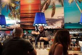 """Jaime Q. mixes a drink at Lolo July 30, 2014 in San Francisco, Calif. Lolo is a restaurant in the Mission featuring """"Jaliscan-Californian inspired cuisine""""."""
