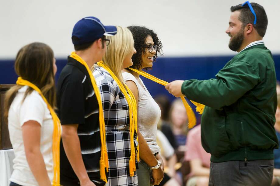 Meridian Principal Patrick Malley places honors cords on the shoulders of Meridian senior Madison Murray during the annual Decision Day event on Thursday, May 17, 2018 at Meridian Early College High School. (Katy Kildee/kkildee@mdn.net) Photo: (Katy Kildee/kkildee@mdn.net)
